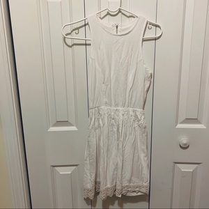 White dress with lace detailing at bottom